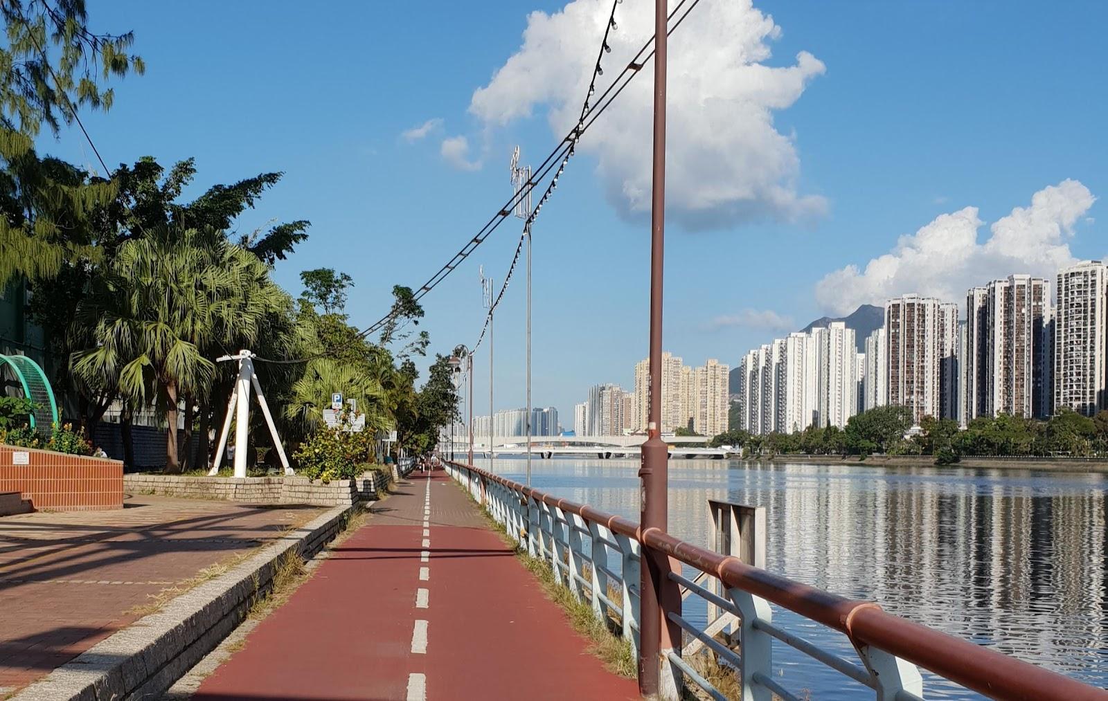 sha tin bike path along the shing mun river while family friendly cycling in hong kong
