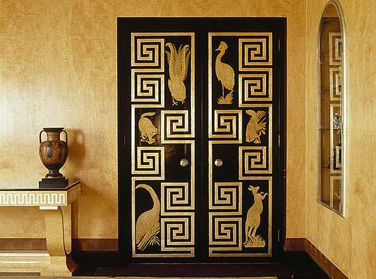 The distinctive dining room doors at Eltham Palace, which feature animals and birds