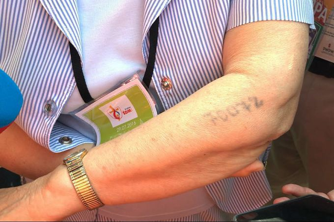 A number tattooed on the forearm of Lidia Maksimovic Bocarova, a survivor of the Auschwitz-Birkenau concentration camp. Credit: Alan Holdren/CNA.