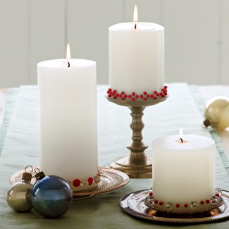 White Pillar candles with push pins decoration