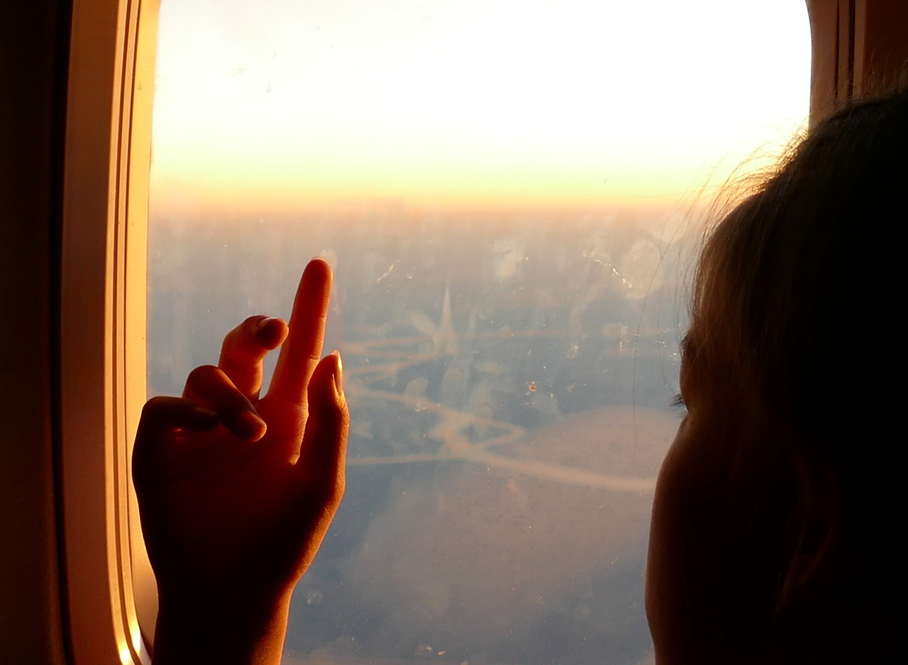 girl hand airplane window free picture