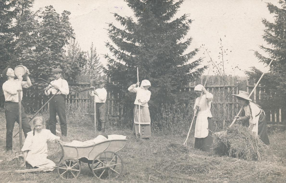 A vintage photo of a group of people posing for the cameraDescription automatically generated