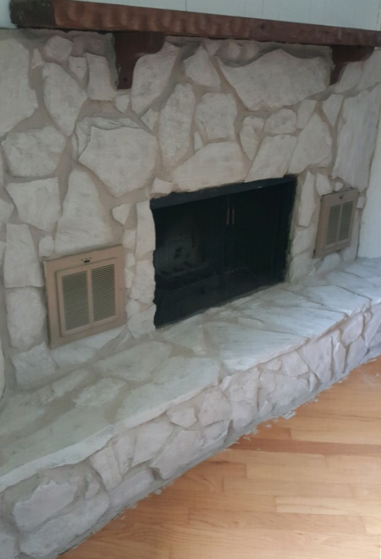 stone fireplace after painting