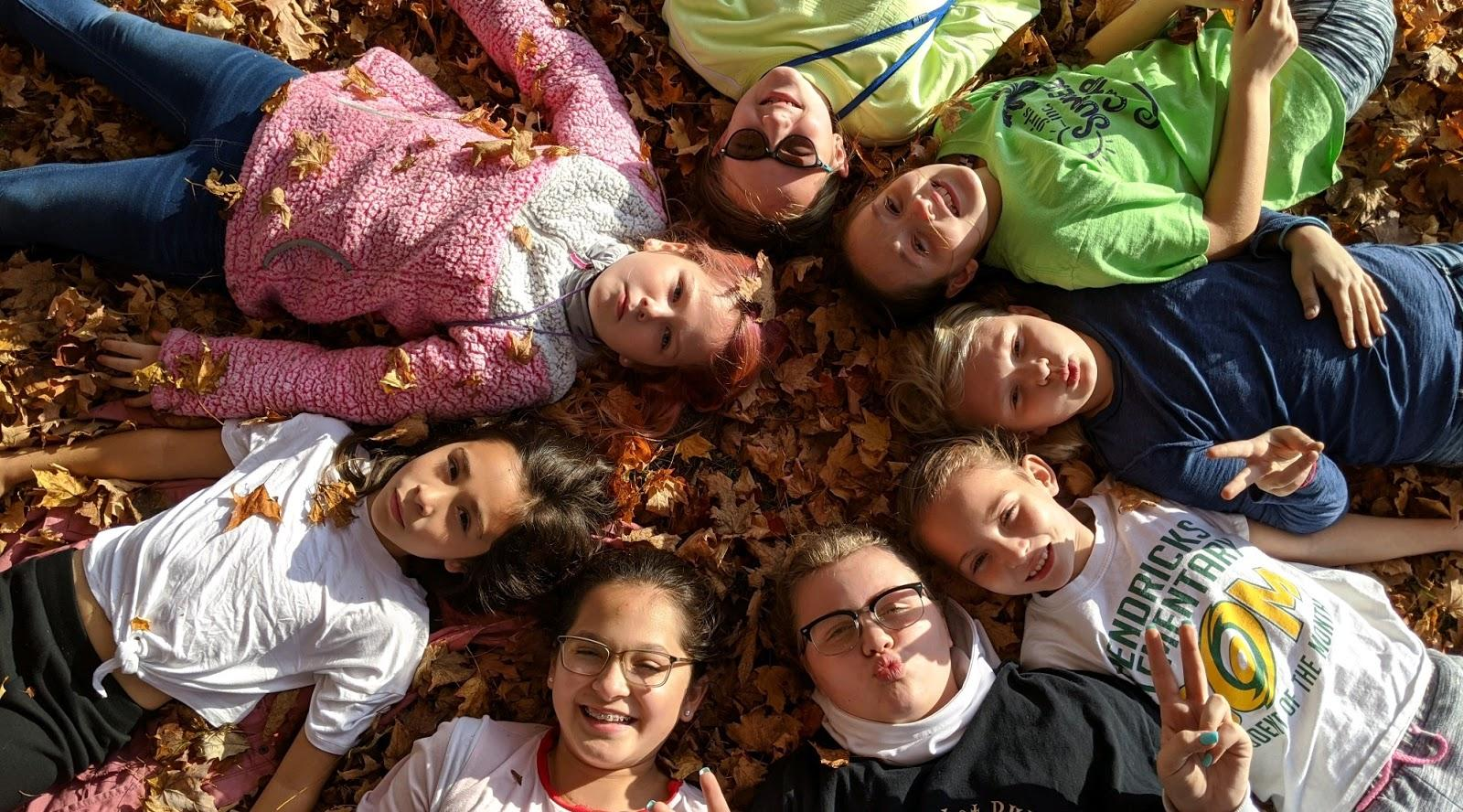 A group of people lying on the ground  Description automatically generated with medium confidence