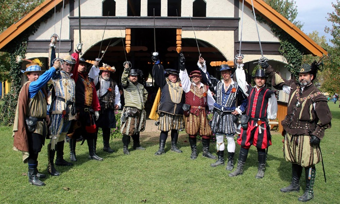 group of men dressed in renaissance costumes holding up rapiers