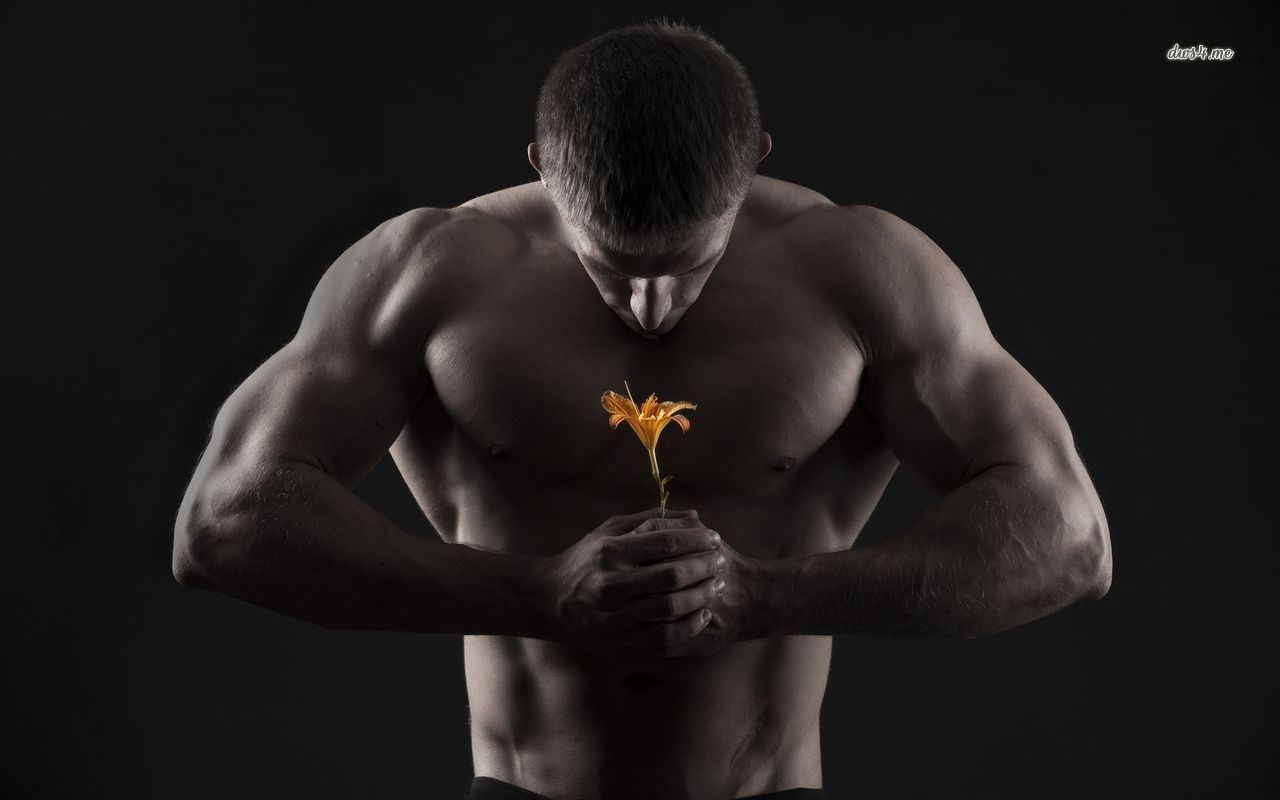 19175-muscular-man-holding-a-lily-1280x800-photography-wallpaper.jpg