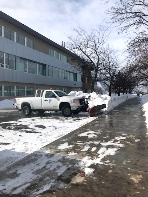 Physical plant workers have been out daily with plows and shovels working to clear snow from walkways and parking lots. Photo by Meritt Drake.