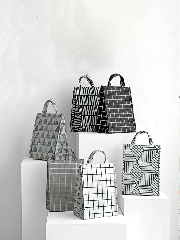 White and black color with  check print  color lunch bags are shown in image.