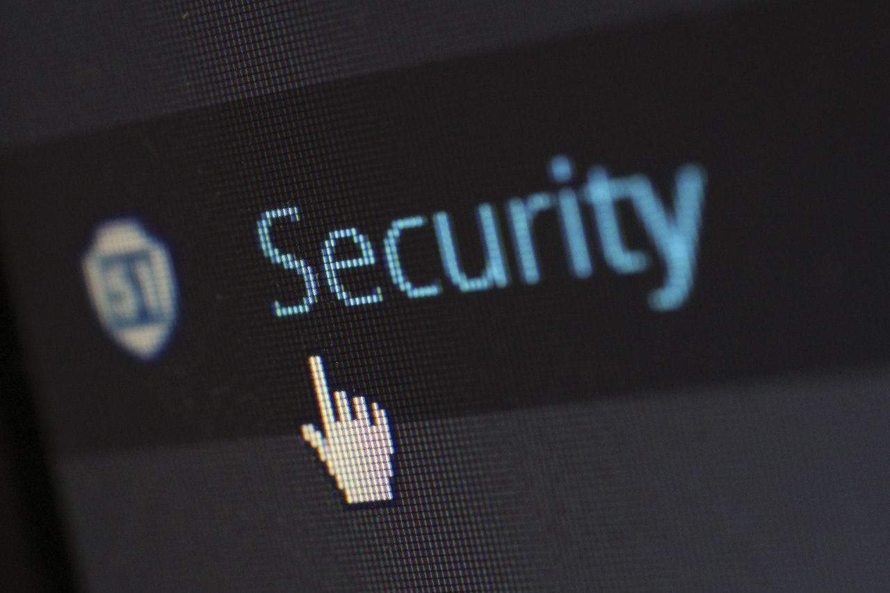 computer screen showing the word security, while the cursor is pointing at it