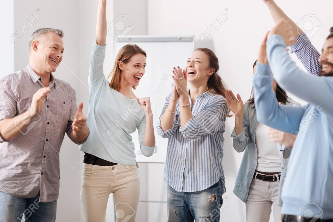 75402215-happy-coworkers-being-very-glad.jpg
