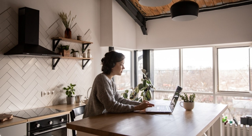 woman researching Airbnb hosting