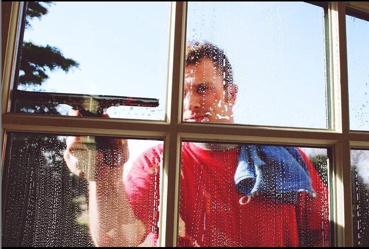 man cleaning window