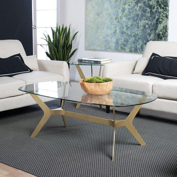 http://cdn.home-designing.com/wp-content/uploads/2021/04/oval-glass-and-metal-coffee-table-brass-living-room-furniture-contemporary-glam-decor-style-ideas-600x600.jpg