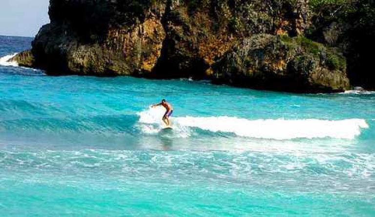 A surfer at Boston Beach   ©Flickr