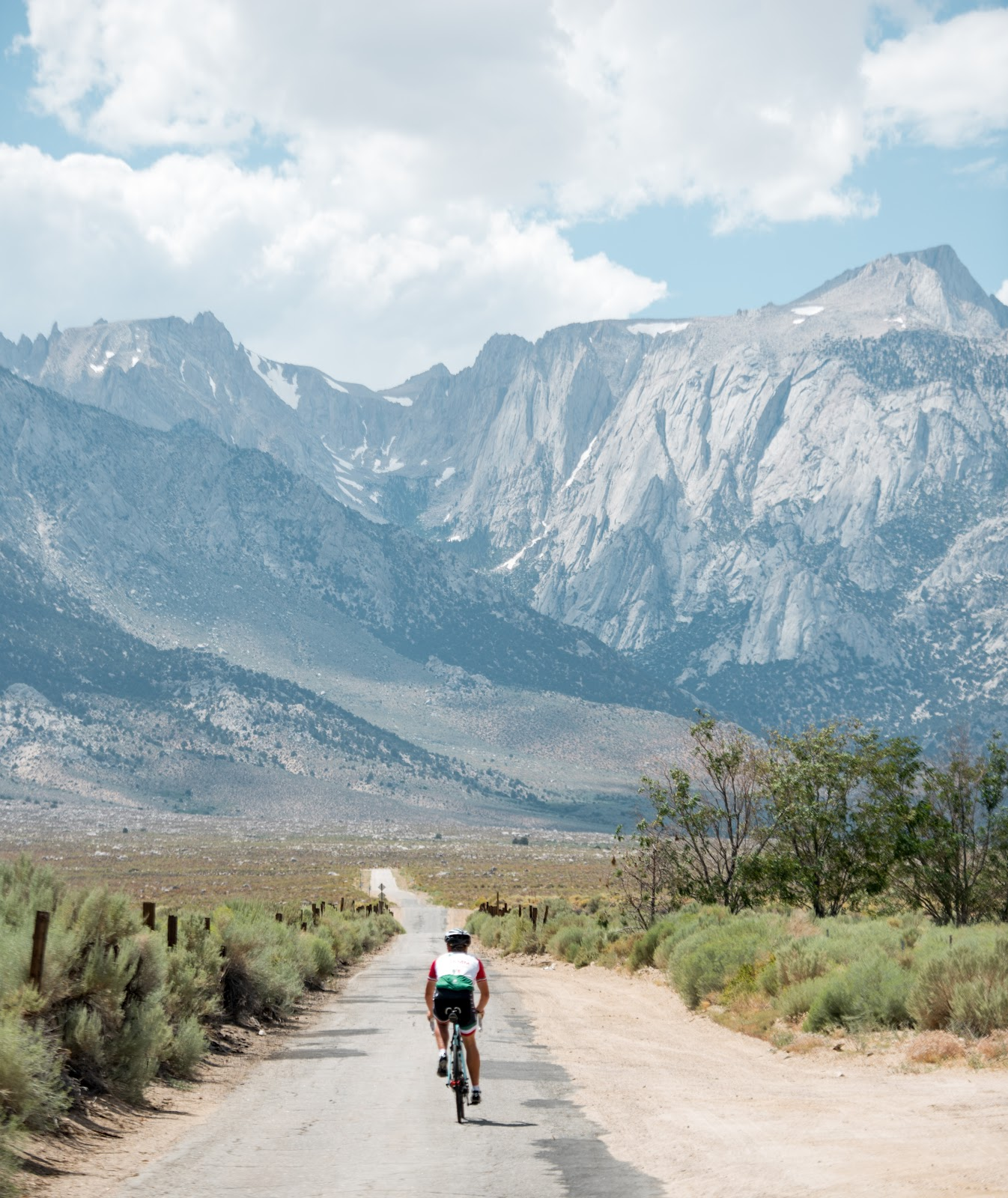 Cyclist riding bike up Lubken Canyon Road, Big Pine, Owens Valley