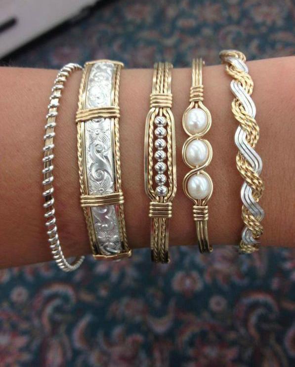 Золоті та срібні браслети з перлами