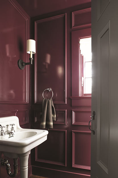Bathroom walls painted in deep purple paint colour in high gloss finish.