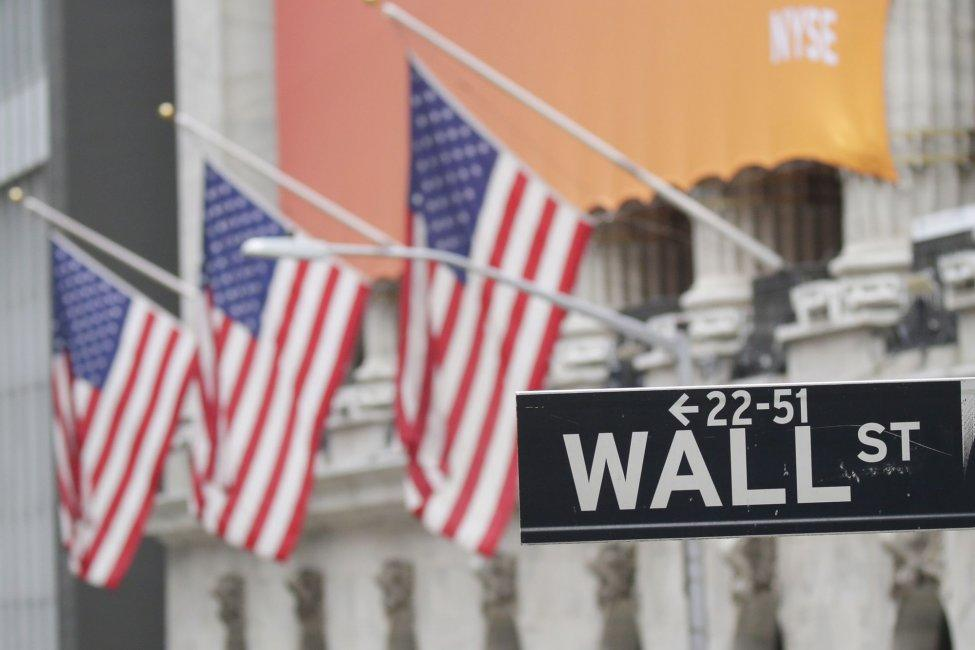 Flags hang outside of the New York Stock Exchange on Wall Street in New York City on July 12. Photo by John Angelillo/UPI