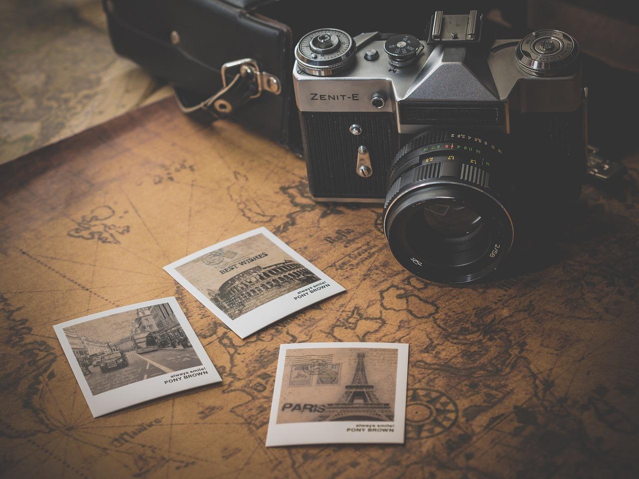 Camera, Printed Photos and Traveling Map