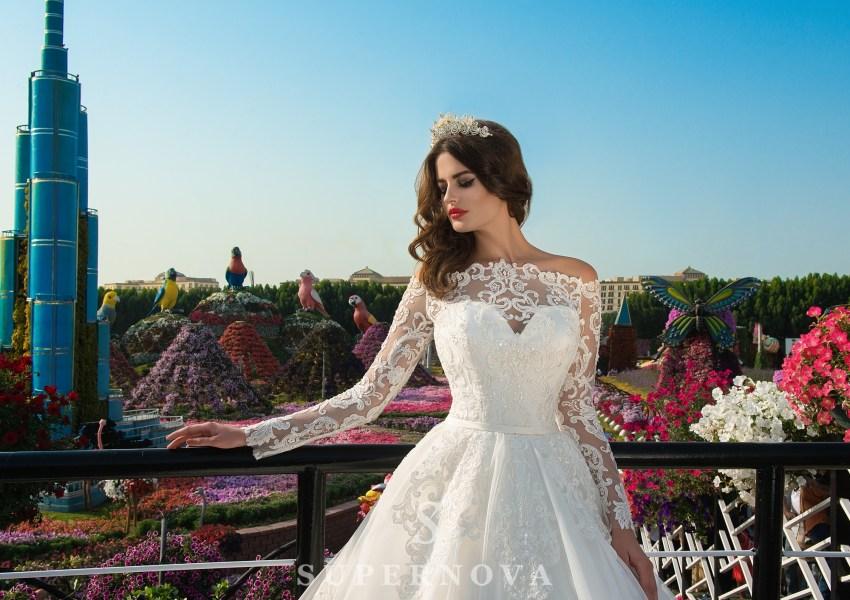 Весільні сукні з мереживними рукавами фото