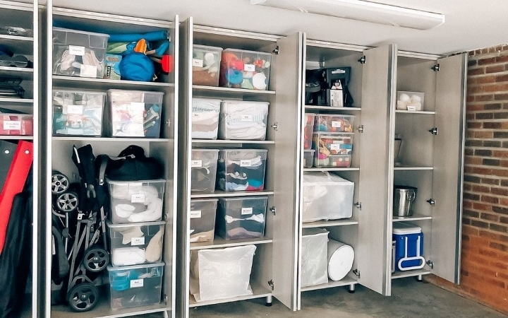 garage organized with items placed in clear plastic bins