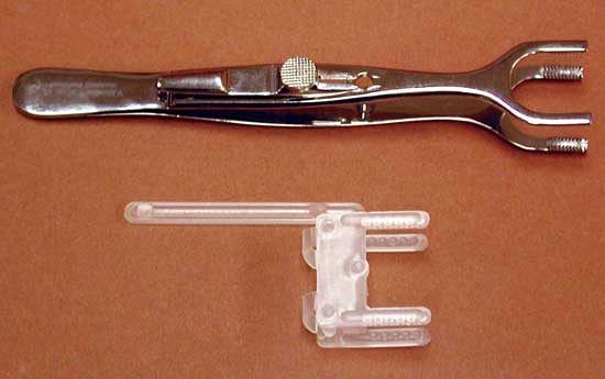 Commercially available, stainless steel and plastic, disposable, muscle biopsy clamps