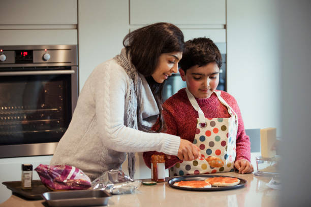 a mother and her autistic child cooking together