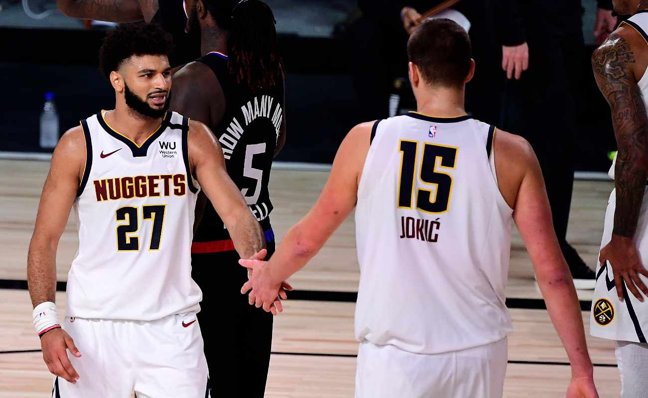 Jamal Murray and Nikola Jokic of the Denver Nuggets tap hands during a game against the LA Clippers.