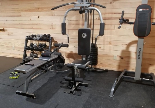 a garage gym with rubber flooring