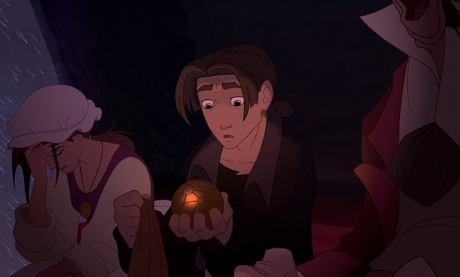 Still from Treasure Planet. Jim Hawkins inspects an ornate golden sphere.