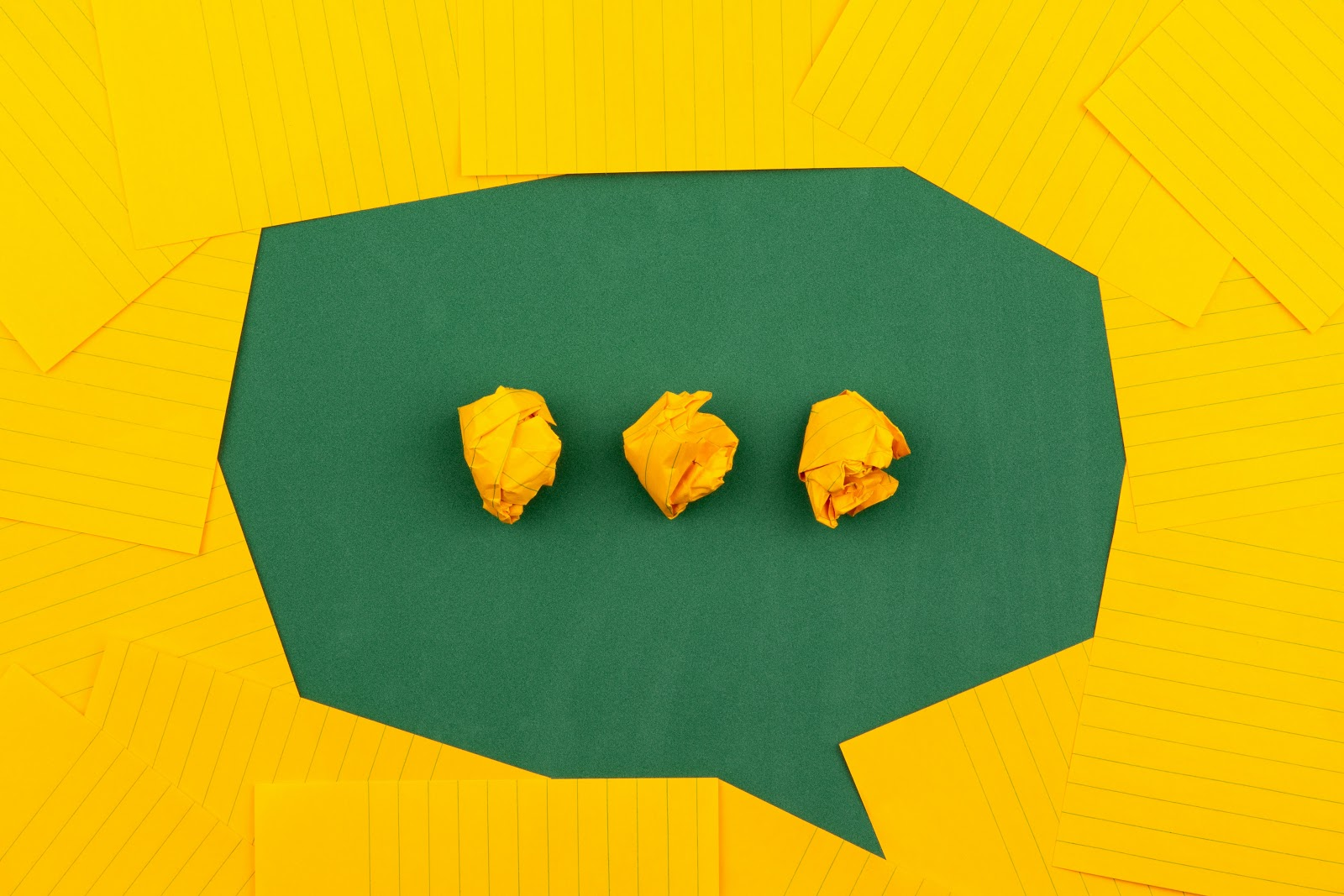 chat bubble icon made out of folded papers