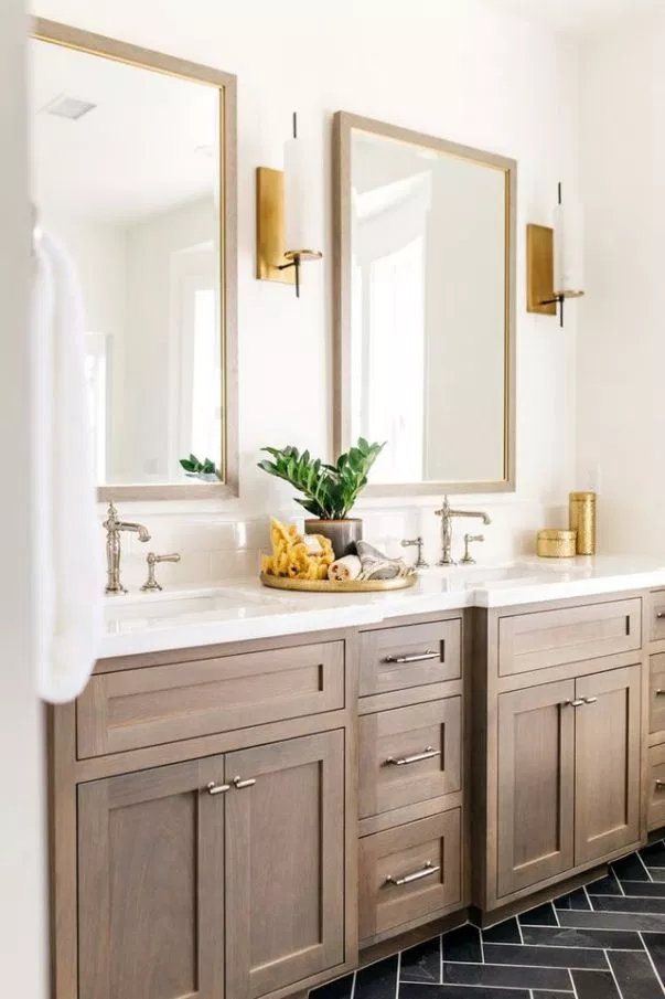 contemporary bathroom design with wood shaker cabinets, brass hardware, double sinks and white countertop