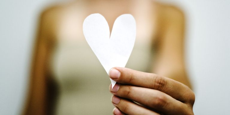 Woman holding a paper heart.