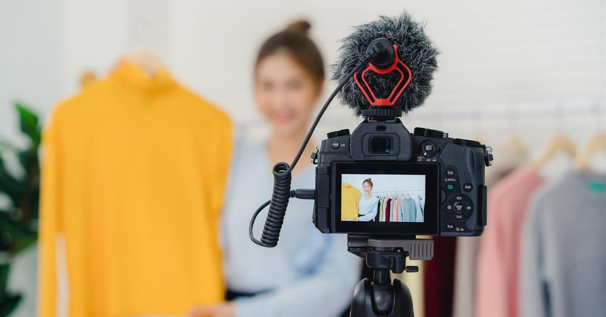 a woman having a commercial shoot for apparel