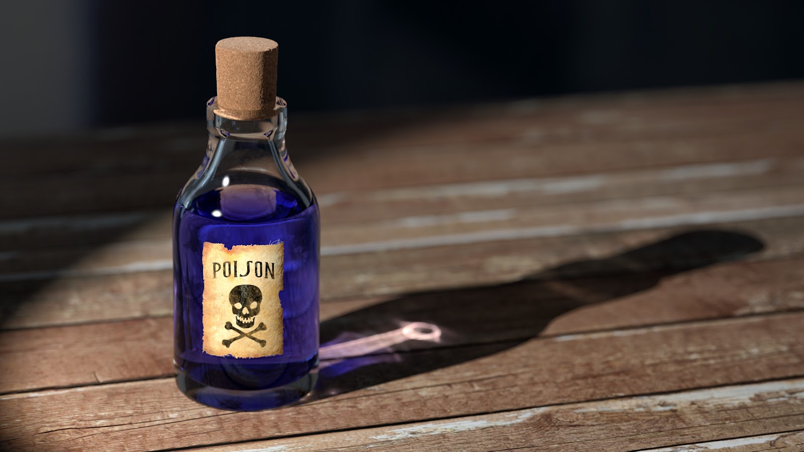 A small glass bottle of purple liquid labeled with a skull and cross bones.