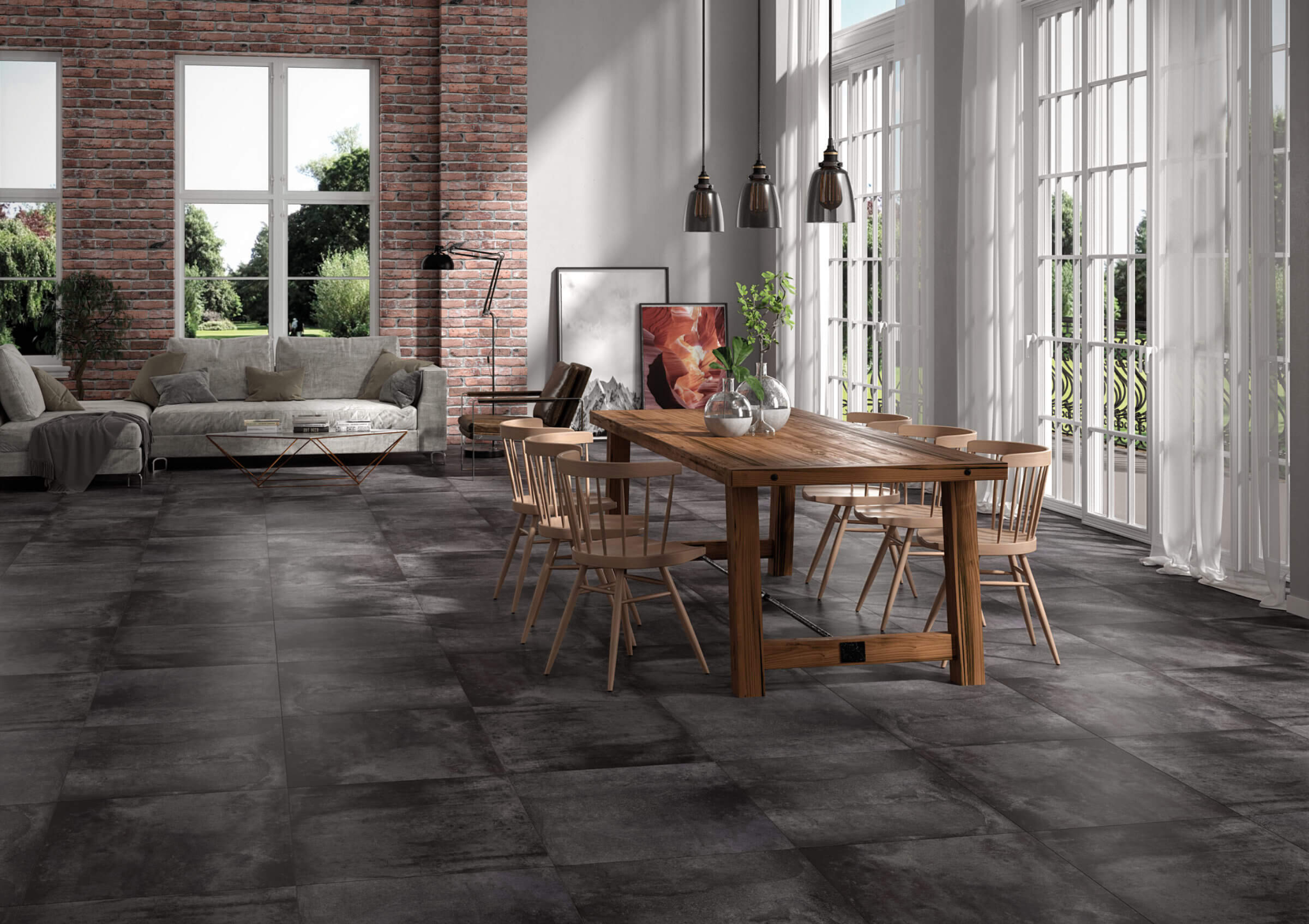 Dining room with oxidized-look black tile flooring