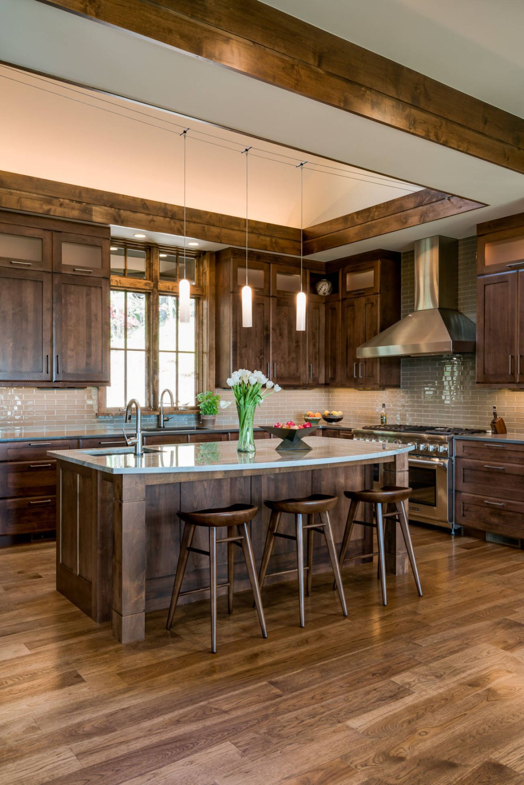 rustic wood kitchen with wood shaker cabinets, wood flooring, wood ceiling beams and a variety of other modern wood finishes