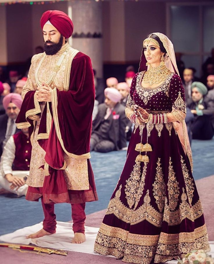 bride and groom sikh wedding wearing traditional clothes.