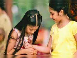 Now, sisters too tie each other a rakhi - Times of India