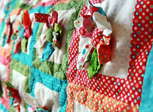 Close-up on Patterned Quilt with 3-D Shapes