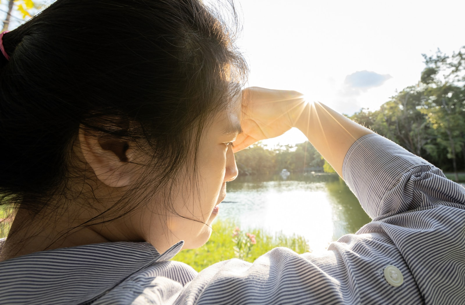 Woman irritated by bright light after eye exam