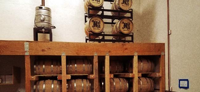 Racks of barrels at Nightside Distillery