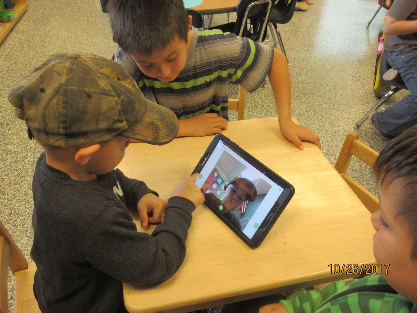 Students looking at tablet