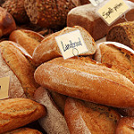 photo of a pile of bread, as in a bakery