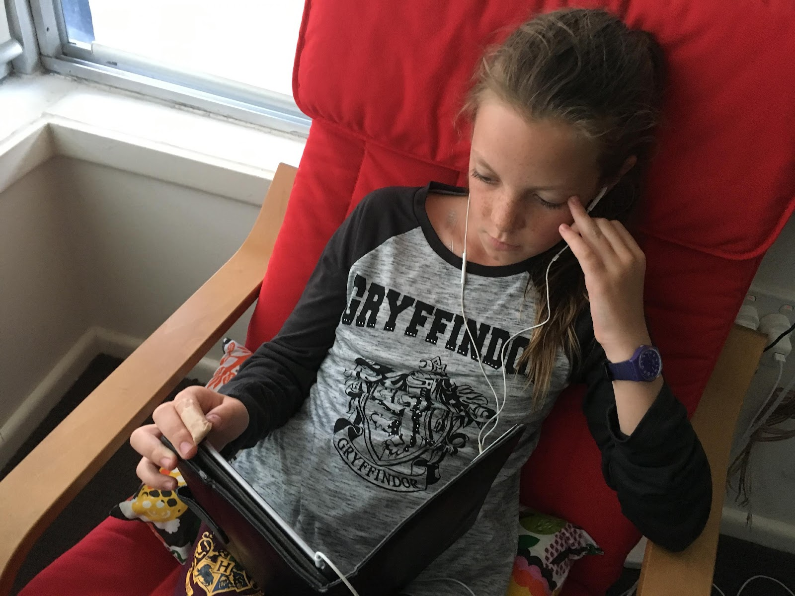 Tween Girl watching Ipad wearing Harry Potter tween wear