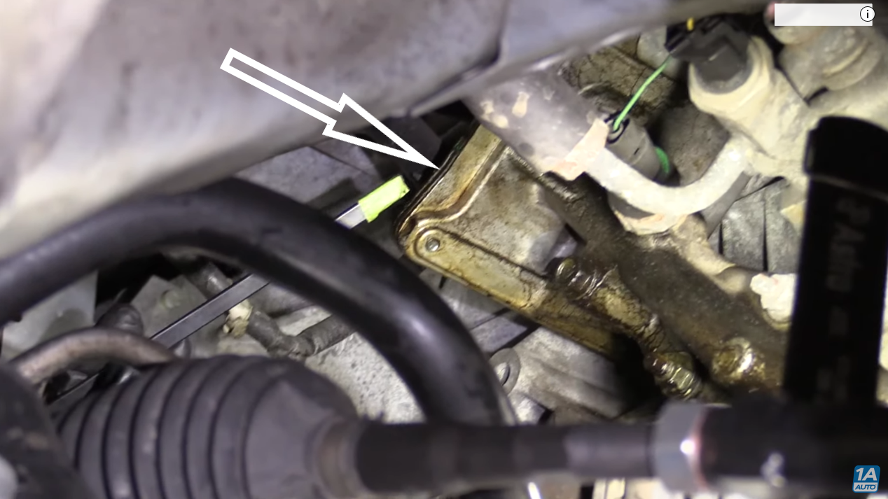 Mechanic diagnosing a leaking oil cooler