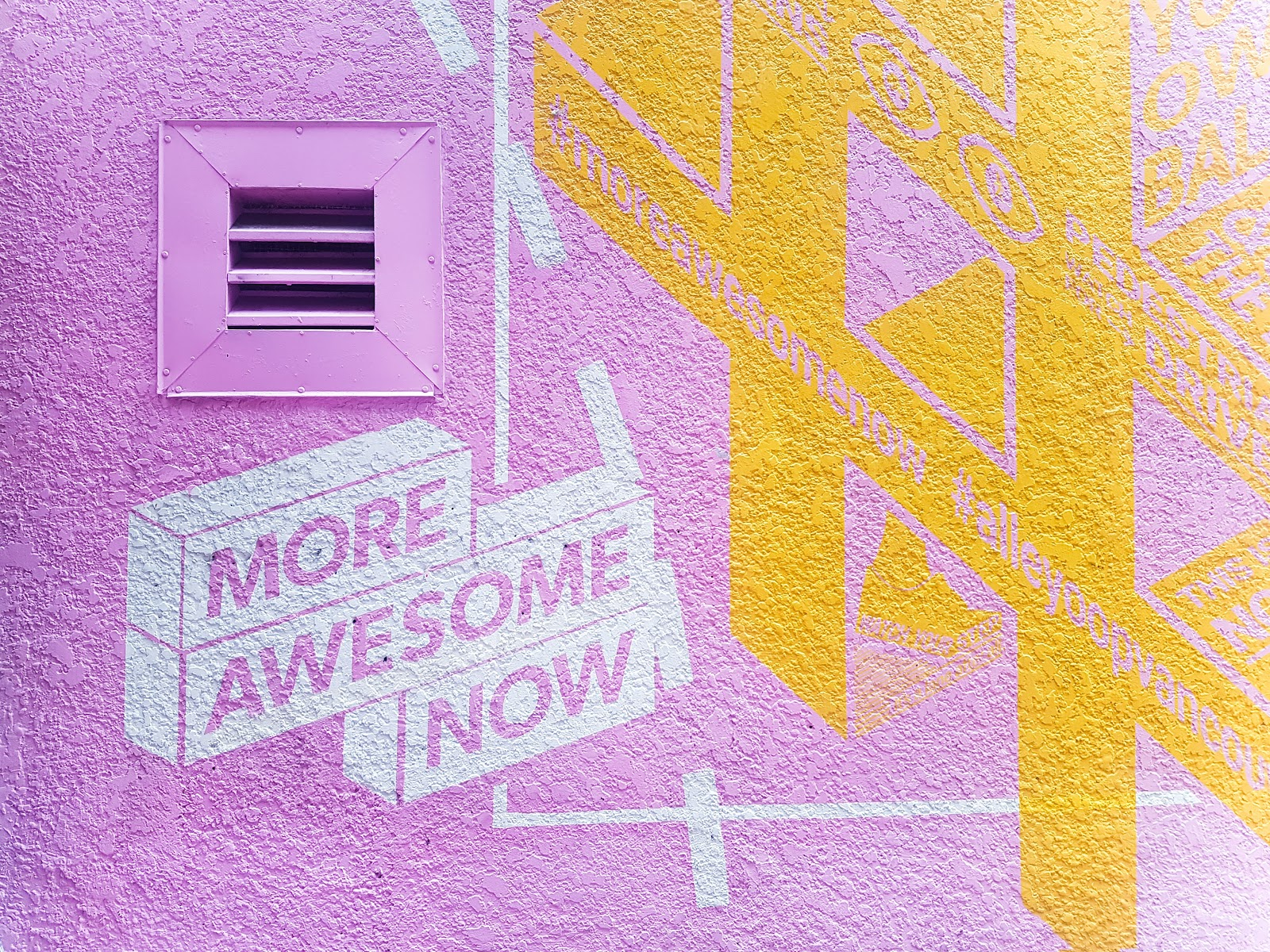 """Mural that says """"More Awesome Now""""."""