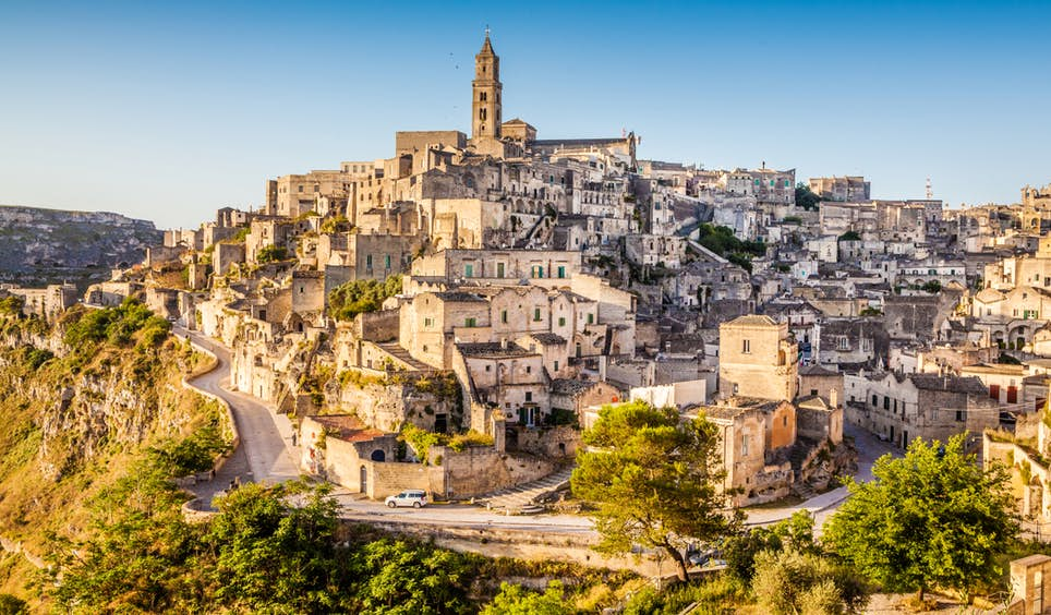 Tumbledown tunnels, alleyways and stone dwellings climb the hillsides of Matera in Italy's Basilicata region © bluejayphoto / iStockphoto / Getty Images