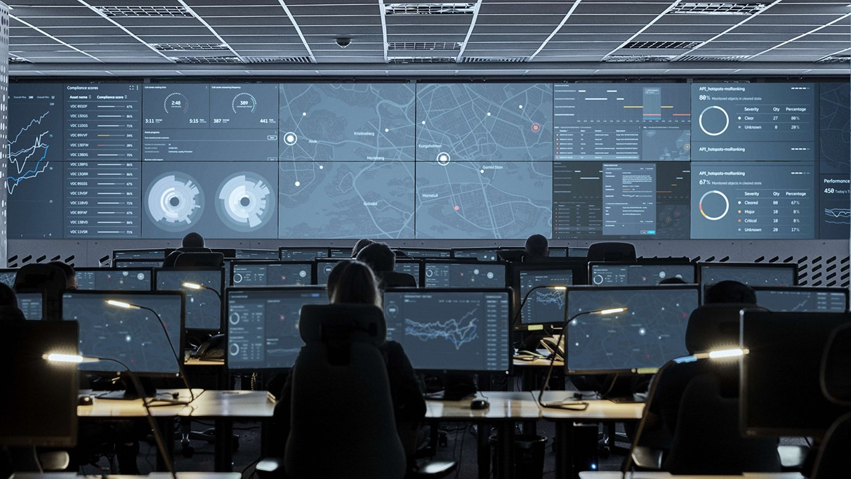 Screens and employees in a Network Operations Center