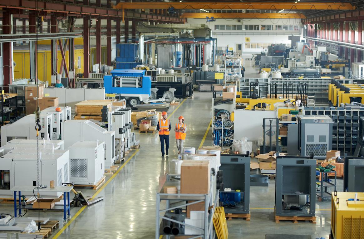 industrial engineers walking in a factory